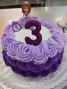 Purple rossettes style round cake with princess on top