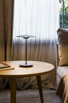 Ginger portable table lamp by Joan Gaspar. A new smaller cordless table lamp. Thanks to a rechargeable lithium-ion battery, the new portable table version of Ginger allows spaces to be lit independently with utter freedom, and with no need for wires.