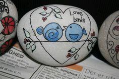 Love birds painted on rocks