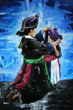 Great picture of mom putting hmong clothes on to baby girl