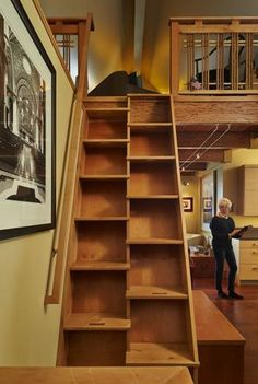 """The TV loft, a private """"away room,"""" sits a quick trip up a ship's ladder. Donna Shirey became a contractor after she built her own home 41 years ago."""
