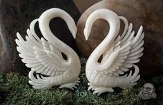 From bodyartforms.com. I loove the way the bone was carved..