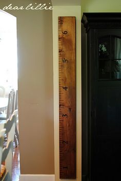 Cute DIY: Turn a 2x4 into a large ruler for the wall, and record the height of your kids as they grow. You never have to worry about moving to a new house. Um, this is genius!