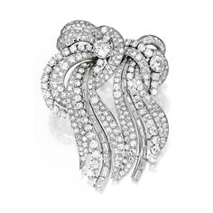 PLATINUM AND DIAMOND DOUBLE-CLIP BROOCH, FRANCE, with French assay and workshop marks, circa 1950.