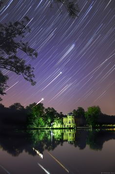 Brilliant Venus and bright Jupiter still rise together before dawn. The peaceful waters by a small lakeside house near Stuttgart, Germany reflect their graceful arcing trails in this composited series of exposures, recorded on the morning of July 26