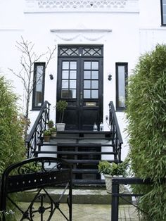 entrance to white terraced townhouse with black door
