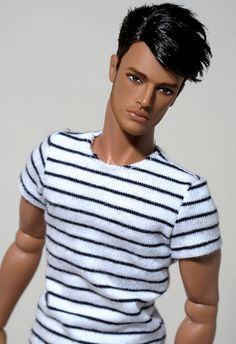 Xavier - male fashion Ken doll.  Not sure if Fashion Royalty or an ooak.  I am sure that he is a hottie!