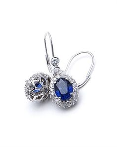 "Adorn: (Valentine Earrings)  (I love the idea of wearing sapphires because they are both of our birth stones)  14k white gold earrings feature diamonds and sapphires. Diamond TW: .8; Sapphire TW: 3.07; 1"" length. Rental jewelry."