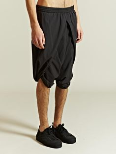 SILENT By Damir Doma Men's Drop Crotch Sarong Shorts. The sarong and other baggy pants, long or short, have always given the air of fluidity to one's movement, which is an honest look if it does not snag easily in today's urban jungle. Also my favorites for home wear.