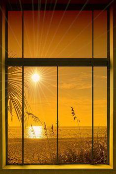 Sunset view on de beach thru de window