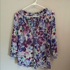 KUT floral blouse Beautiful floral blouse, buttons up and ties at the bottom. Size M. Like new!  Worn once! KUT Tops Blouses