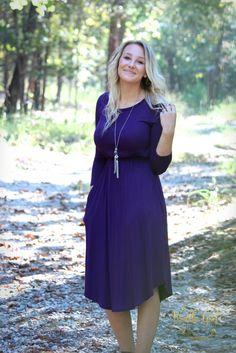 Purple midi dress with cinched waist and pockets