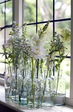 A simple arrangement of glass vases on a window sill is perfect for bringing a touch of spring to your home.A simple arrangement of glass vases on a window sill is perfect for bringing a touch of spring to your home.