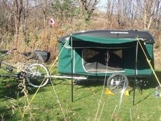 Trans Canada Trailer Companys R-Escape bike camper trailer towed by a tandem bicycle