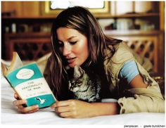 "Brazilian model Gisele Bündchen reads with cat in Elle Italia February 2009. Bündchen (born 1980) is the goodwill ambassador for the United Nations Environment Programme. In the late 1990s, Bündchen became the first in a wave of Brazilian models to find international success. In 1999, Vogue dubbed her ""The Return of the Sexy Model,"" and she was credited with ending the ""heroin chic"" era of modeling."