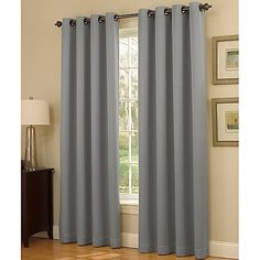The attractive Insola Dorian Thermalayer Grommet Top Window Curtain Panel features a solid, white thermal liner and helps to darken rooms and save on energy costs. The panel also easily hangs with stylish grommets.