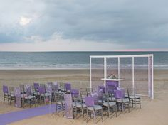 Purple+Shimmer+wedding+setup+on+the+beach.
