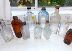 SALE COOL LOT Of 10 Collectible Antique Glass Medicine Bottles Jars With Original Lids Liquor Alcohol Home Remedies Doctor Patient Available now via Orphaned Treasures Etsy
