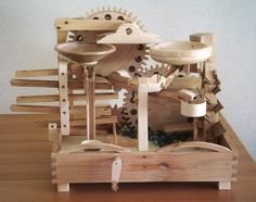 """Artist's statement starts: """"There's nothing to do in the garden in the winter, so I have time to tinker."""" Seven amazing marble machines by Paul Grundbacher Cool Woodworking Projects, Wood Projects, Projects To Try, Teds Woodworking, Rolling Ball Sculpture, Wood Crafts, Diy And Crafts, Marble Toys, Kinetic Toys"""