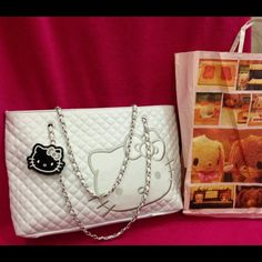 🎉Authentic white hello kitty bag.🎉 Authentic hello kitty white bag. Brand new with tag. Bought it @Sanrio store in singapore when I was there for vacation. It's pretty but I never used it so I decided to sell it than just sitting in my closet.  So give me your best offer😉 Hello Kitty Bags