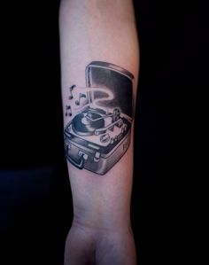 I want a record player tattoo some day! Something like this...