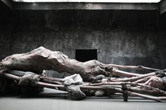 berlinde de bruyckere's 'cripplewood' at the 2013 venice art biennale is an enormous wax installation that accurately reproduces a vast fallen tree trunk.