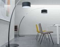 Ligne Roset Black Floor Lamp   With 15% off this large floor lamp with pivoting stem in square-section curved metal is finished in satin-finish black lacquer and brilliant chrome for the pull-out section.