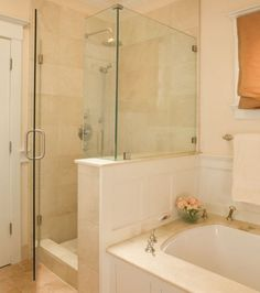 Traditional bathroom featuring an under-mount tub with elegant fixtures