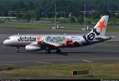 Jetstar Japan (JP) Airbus A320-232 JA01JJ aircraft, painted in ''Angry Birds Movie'' special colours Jul. 2016, skating at Japan Sapporo New Chitose Airport. 01/07/2016. (Angry Birds=a 3D computer-animated action-adventure comedy).