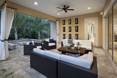Host game night in this luxurious indoor/outdoor space perfect for the whole family or a group of friends from Coastal Oaks at Nocatee - Heritage, Anastasia Mediterranean home in Ponte Vedra, Fla.