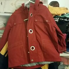 Lil boys Fireman rain coat Childs Red fireman jacket with hood and zipper closure...2 pockets in front... never worn still brand new size small (4) carters Jackets & Coats
