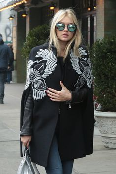 Gigi Hadid in my favourite coat/cape of the season, love love love the embroidery on this Stella McCartney offering . . .