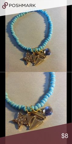 Beaded Gemstone Charm Bracelet This is a blue beaded stretch bracelet with a gold star, boat  and Blue Agate gemstone charm. This is perfect for layering for a boho festival look! Suncoast Studio Clearwater Jewelry Bracelets