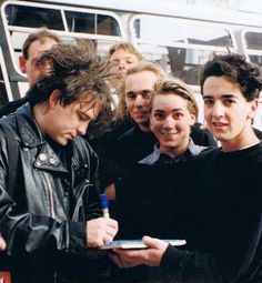 Robert Smith of The Cure Signing Autographs