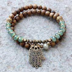 Wood and green crystal 54 bead wrap mala bracelet with Hamsa hand by #lovepray #jewelry .