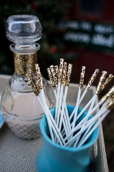 gold glitter swizzle sticks, photo by Isa Images http://ruffledblog.com/rhode-island-winter-wedding-ideas #diy #glitter #wedding