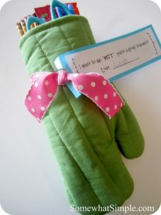 """I have to ""ad-MITT"", you're a great teacher!""  Fill a fun oven mitt with treats like scissors, pencils, candy, or maybe some recipes!    Use some of these cute sayings attached to treats: http://www.skiptomylou.org/2007/05/06/teacher-appreciation-week/"