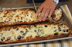 2 loaves of French bread, 1 jar of pizza sauce, whatever toppings your family likes, topped with mozzarella cheese; bake at 500 for 5-6 mins.