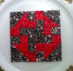 """Block # 70 """"Prairie Queen"""" easy block and striking in black & red. This block would make a beautiful quilt."""