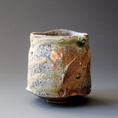 Yunomi (tea cup) - Natural wood ash, Woodfired * Natural wood ash: pottery surface is left unglazed and takes on color and markings during the firing from the melted wood ash 3.5 x 3.5 x 3.5 inches Shipping and Policy (y-91)
