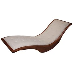 Rocking wood and linen chaise longue by Igor Rodrigues