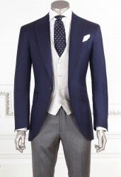 Dark Blue Half Morning Suit JACKET: 1 button, peak lapel, 1 slit; Dark Blue Color Fabric: 100% wool yarn, super 140, 250 gr PANTS: Without pince; pocket American, primer 20; Gray Fabric: 100% wool, yarn 120's, 250 gr WAISTCOAST 4 Buttons, Pear color Fabric: 100% silk