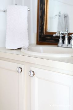 Looking for a budget makeover? This bathroom sink cabinet makeover updated a basic sink cabinet with DIY chalk paint and new cabinet knobs from Anthropologie | In My Own Style