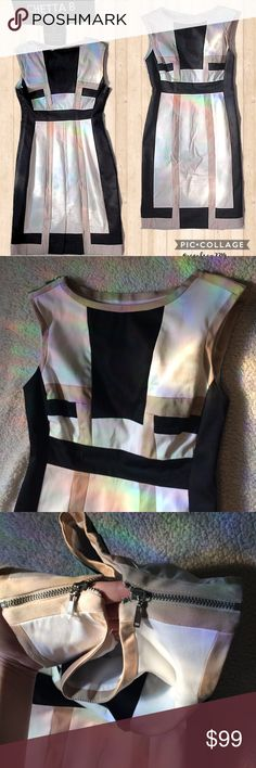 """NWOT Chetta B colorblock dress size 2 Note-UK brand and sizing! Size 0/00 Us NWOT unique Chetta B colorblock dress size 2 Still has plastic over one of the zipper pulls on the shoulders, doubt it's ever been worn! Approx 26/28"""" chest, 34"""" length Excellent condition with no noted stains rips tears. Small thread pull noted on back lower left of garment, should be trimmable-pictured Side zip and zipper on the tops of the sleeves Material content tag pictured Black tan white, backslit Chetta B…"""