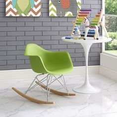 Rocker Kids Chair, Green - Train them young with the kid version of the iconic Rocker Lounge Chair. Seeing kids importune some thrilling moments on the adult version, we knew it was time to bring one of the wonders of the furniture world down a few candles on the birthday cake. This stylish kid version features the much beloved organic plastic seat form, solid stainless steel frame, and wood rocker base, shrunk down to size so that kids can be kids on the kid version; and adults can remain…