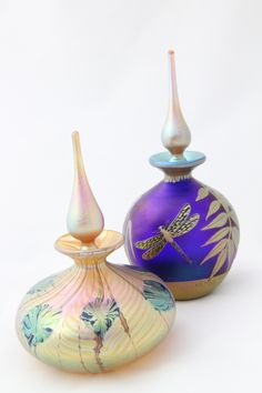 Two gorgeous Okra perfume bottles.