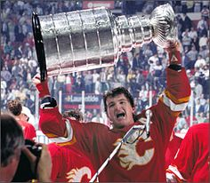 Al MacInnis hoisting the Stanley Cup following the Calgary's Cup win over Montreal in 1989.