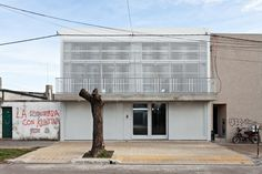 4 Dwellings With Courtyard / SMF Arquitectos