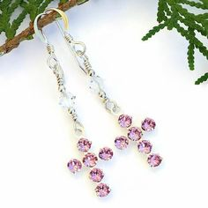 The SPARKLING LOVE Christian cross earrings are filled with incredible sparkle.  The handmade earrings feature glittering pink Swarovski crystal crosses with a silver plated backing.  Clear Swarovski