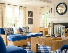 In this Nantucket living room, T. Keller Donovan turns tradition on its head: Wicker furniture has surprisingly modern silhouettes; the plaid rug has an oversize scale and he put a fresh spin on the classic convex mirror by painting it blue and white.